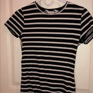 A white and black striped tie black tee
